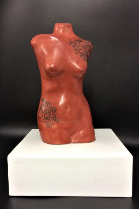 red iron oxide slip-cast torso in earthenware